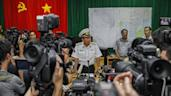 Vietnamese Navy Deputy Commander Rear Admiral Le Minh Thanh (C) speaks to reporters during a press conference on search activities for the missing Malaysia Airlines flight 370 in Phu Quoc island on March 12, 2014