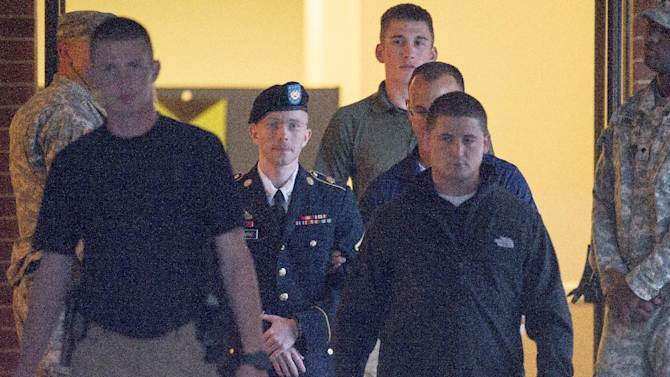 Army Pfc. Bradley Manning is escorted out of a courthouse at Fort Mead, Md, Friday, July 26, 2013. Manning is charged with indirectly aiding the enemy by sending troves of classified material to WikiLeaks. He faces up to life in prision. (AP Photo/Cliff Owen))