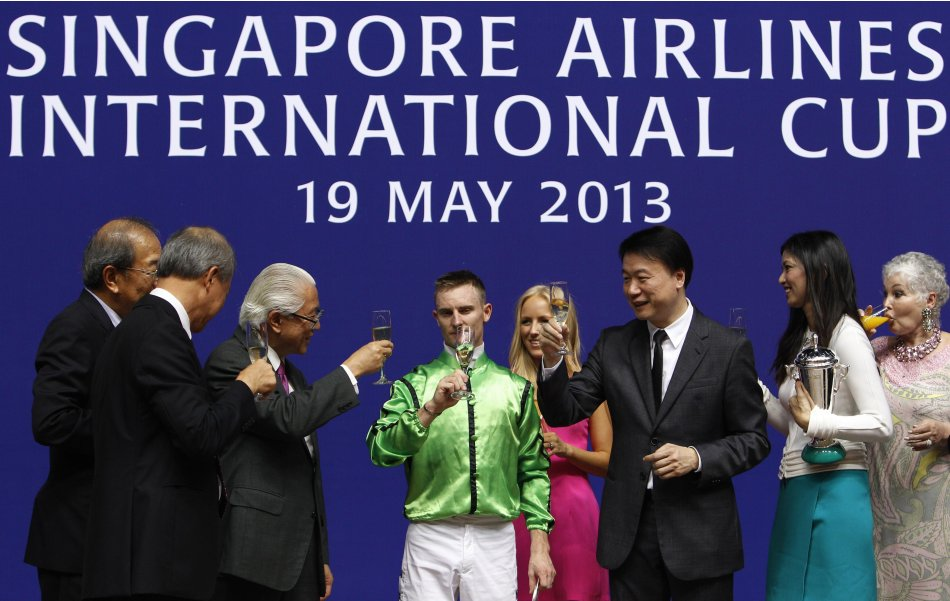 Jockey Purton, horse owners Lo and his wife, are congratulated by Singapore's President Tan after Military Attack of Hong Kong won SIA International Cup horse race