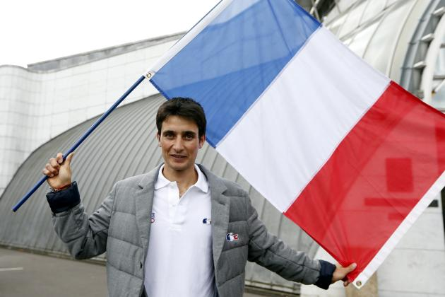 French athlete Jason Lamy-Chappuis poses with the French national flag during a presentation of the French Olympic team in Paris