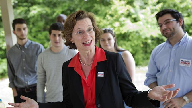 """FILE - This May 13, 2014, file photo shows Georgia Democratic Senate hopeful Michelle Nunn as she greets campaign volunteers at South DeKalb Community Achievement Center in Decatur, Ga. Nunn has endured the initial storm of a leaked campaign memo that laid bare her own campaign's strategies and discussed her potential weaknesses as an Atlanta nonprofit executive who grew up outside of Georgia. But Republicans and Democrats agree that the real hits from the unusual misstep will come later, as Republican David Perdue and the independent Super PACs that support him use the Nunn campaign's own words """"and go nuclear on her"""" in the coming deluge of television ads. (AP Photo/David Goldman, File)"""