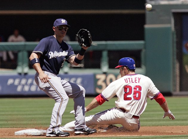Philadelphia Phillies' Chase Utley beats the throw to Milwaukee Brewers' Cody Ransom as he steals second in the second inning of a baseball game, Wednesday, July 25, 2012, in Philadelphia. (AP Photo/Tom Mihalek)