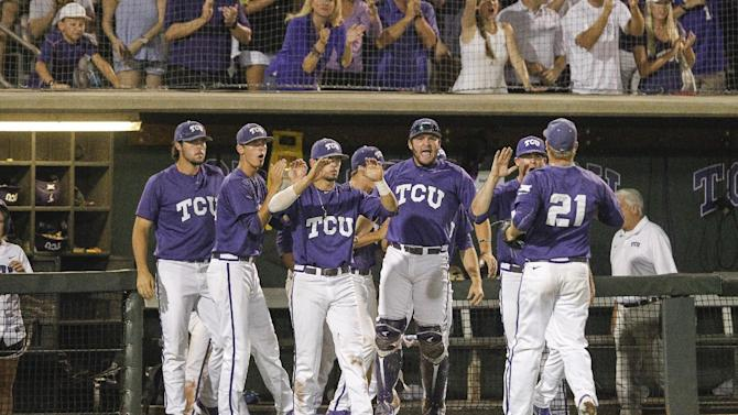 TCU pitcher Brian Trieglaff  (21) is congratulated by teammates in the tenth inning at the Fort Worth Regional of the NCAA college baseball tournament in Fort Worth,Texas, on Monday, June 1, 2015. TCU won 9-8.  (AP Photo/Tim Sharp)