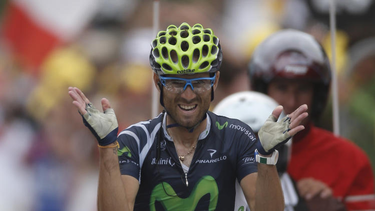 Alejandro Valverde of Spain crosses the finish line to win the 17th stage of the Tour de France cycling race over 143.5 kilometers (89.2 miles) with start in Bagneres-de-Luchon and finish in Peyragudes, Pyrenees region, France, Thursday July 19, 2012. (AP Photo/Laurent Rebours)