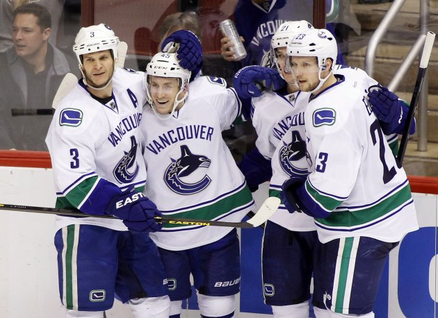 Canucks' Schroeder is congratulated after goal against the Coyotes during their NHL game in Glendale.
