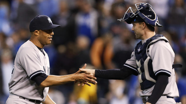 New York Yankees relief pitcher Mariano Rivera, left, is congratulated by catcher Chris Stewart following the Yankees' 3-2 win in a baseball game against the Kansas City Royals at Kauffman Stadium in Kansas City, Mo., Saturday, May 11, 2013. (AP Photo/Orlin Wagner)