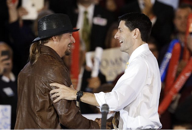 Republican vice presidential candidate, Rep. Paul Ryan, R-Wis., right,  is introduced by recording artist Kid Rock at a rally at Oakland University in Rochester, Mich., Monday, Oct. 8, 2012. (AP Photo