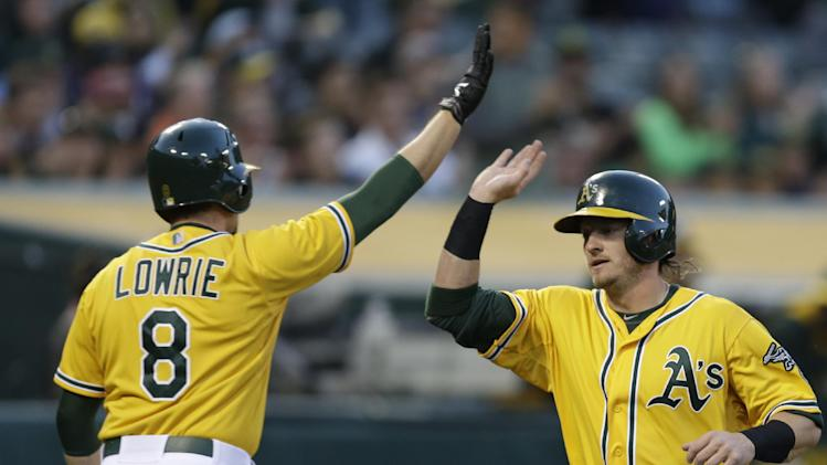 A's come out swinging to beat Astros 11-3