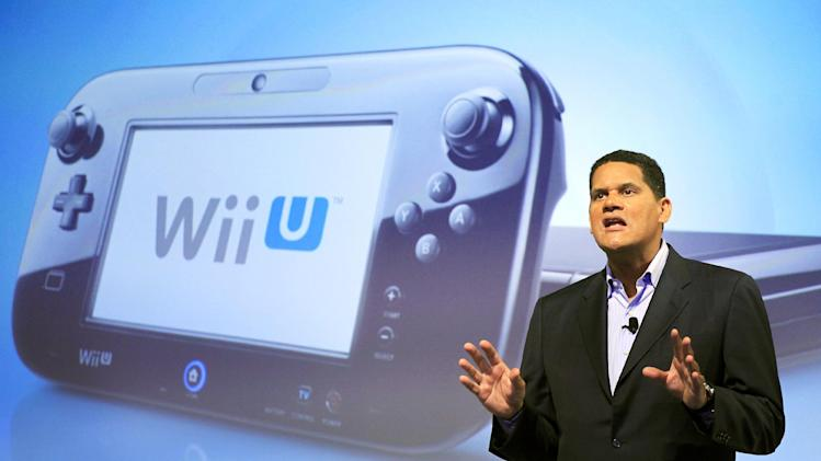 FILE - In this Sept. 13, 2012 photo, Reggie Fils-Aime, president and chief operating officer of Nintendo of America, discusses the upcoming Wii U gaming console, in New York. Much like the iPad, the curvey GamePad features a touchscreen that can be manipulated with the simple tap or swipe of a finger, but it's surrounded by the kinds of buttons, bumpers, thumbsticks and triggers that are traditionally found on a modern-day game controller. The gaming console will start at $300 and go on sale in the U.S. on Sunday, Nov. 18, in time for the holidays, the company said. (AP Photo/Mark Lennihan, File)