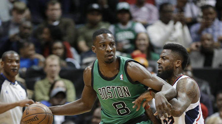 Boston Celtics forward Jeff Green (8) drives against Atlanta Hawks guard DeShawn Stevenson (92) in the first half of an NBA basketball game Friday, Jan. 25, 2013, in Atlanta. (AP Photo/John Bazemore)