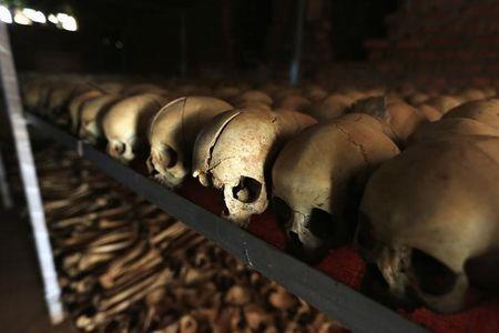 Preserved skulls are spread out on metal shelf in Catholic church in Nyamata