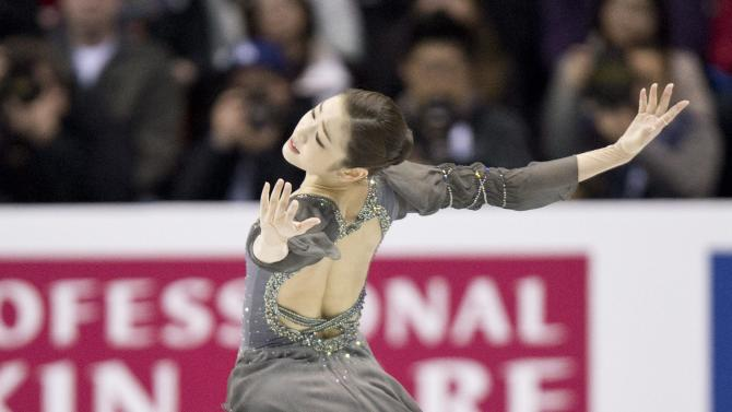 Kim Yu-na from South Korea performs her free program at the World Figure Skating Championships Saturday, March 16, 2013 in London, Ontario. (AP Photo/The Canadian Press, Paul Chiasson)
