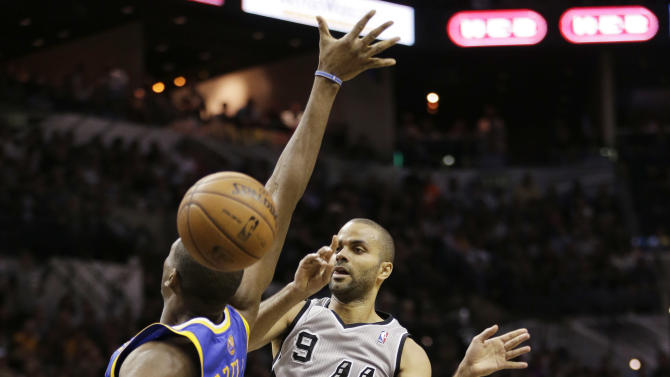 San Antonio Spurs' Tony Parker (9), of France, passes around Golden State Warriors' Festus Ezeli, left, during the first half in Game 5 of a Western Conference semifinal NBA basketball playoff series, Tuesday, May 14, 2013, in San Antonio. (AP Photo/Eric Gay)
