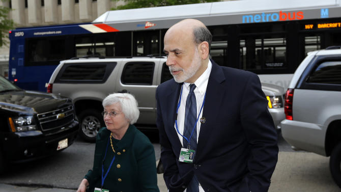 Federal Reserve Chairman Ben Bernanke, right, arrives for a G-20 dinner, during the Spring Meetings of the World Bank Group and the International Monetary Fund Thursday, April 18, 2013, in Washington. (AP Photo/Alex Brandon)