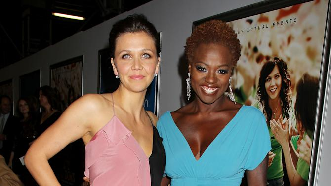 "FILE - This Sept. 23, 2012 file photo released by Starpix shows actress Maggie Gyllenhaal, left, and Viola Davis at the premiere of their film ""Won't Back Down,"" in New York. The movie was a box-office dud, but its creators have more than ticket sales in mind.  They hope the classroom drama about two single moms in Pittsburgh trying to save their kids' failing inner-city school also sparks a wave of activism while igniting widespread legal changes giving parents more control over how their children learn. (AP Photo/Starpix, Dave Allocca, File)"