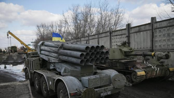 Multiple rocket launcher system belonging to the Ukrainian armed forces is pictured before it was loaded onto a wagon of a cargo train at a train station in Artemivsk