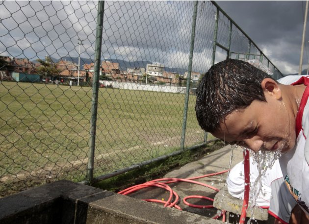 A boy cools down after a soccer clinic organised by former Brazilian soccer player Jairzinho in Varginha slum, Rio de Janeiro