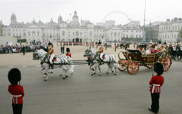 Britain's Prince William and his wife Kate, Duchess of Cambridge pass through Horse Guards Parade, enroute to Buckingham Palace following their marriage at Westminster Abbey  in London, Friday, April