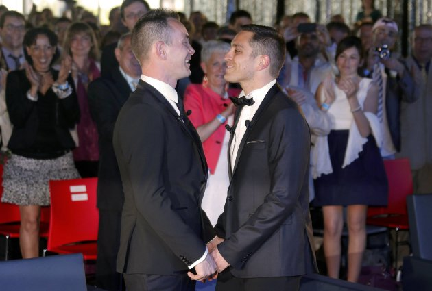 Vincent Autin and Bruno Boileau hold hands after getting married at the town hall in Montpellier