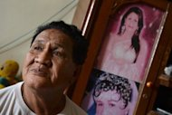 Yoti Oktosea, a 70-year-old Indonesian transgender and former sex worker, poses for a photograph on January 29, 2013. Until two years ago, the official government line on transgender people was that they were mentally ill