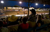 Kolton Brown, 2, sits atop his father's shoulders while watching the Frontier Days Rodeo, Wednesday, July 3, 2013 in Prescott, Ariz. A mile-high city about 90 miles northwest of Phoenix, Prescott remains a modern-day outpost of the pioneer spirit. It's that spirit that will guide officials as they navigate the days ahead and figure out how to honor the elite Hotshot firefighters who died in a nearby wind-driven wildfire that is still burning. (AP Photo/Julie Jacobson)