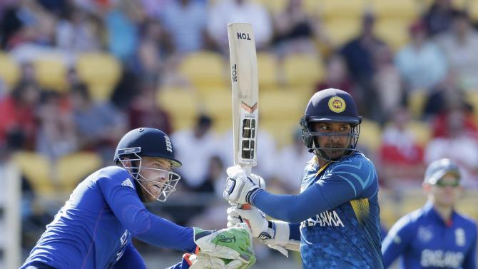 England's Buttler watches Sri Lanka's Sangakkara hit a boundary during Cricket World Cup match in Wellington