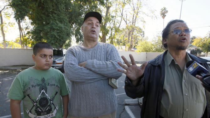 From left, Mohammad Atia with his father Gamal Atia , and Muhammad Sanusi speak near their home in Pomona, Calif., Tuesday Nov.20, 2012,  about their neighbor, Sohiel Omar Kabir who was arrested along with three other men accused of plotting to kill Americans and destroy U.S. targets overseas by joining al-Qaida and the Taliban in Afghanistan. ( AP Photo/Nick Ut)