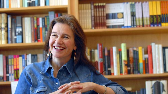 """FILE - This May 16, 2008 file photo shows author Louise Erdrich at her store BirchBark Books in Minneapolis. Erdrich, 58, won a National Book Award Wednesday, Nov. 14, 2012, for her story, """"The Round House"""" the second of a planned trilogy, about an Ojibwe boy and his quest to avenge his mother's rape. Erdrich, who's part Ojibwe, spoke in her tribal tongue and then switched to English as she dedicated her fiction award to """"the grace and endurance of native people."""" (AP Photo/Dawn Villella, file)"""