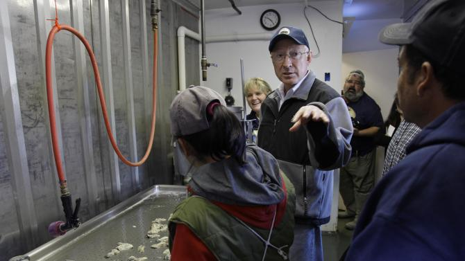 In this photo taken Wednesday Nov. 21, 2012, U.S. Interior Secretary Ken Salazar gestures while speaking with workers during a tour of the Drakes Bay Oyster Company in Point Reyes National Seashore, Calif. Salazar on Thursday, Nov. 29, 2012, said he will shut down the historic oyster farm designating the site as a wilderness area. Salazar also said he will not renew the Drakes Bay Oyster Co. lease that expires Friday. The move will bring a close to a years-long environmental battle over the site. (AP Photo/Eric Risberg)