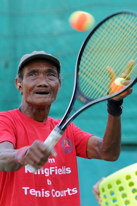 "TO GO WITH AFP STORY ""Tennis-Davis-CAM-history-KRouge,FEATURE"" By Michelle Fitzpatrick Cambodian Yi Sarun, A Tennis AFP/Getty Images"