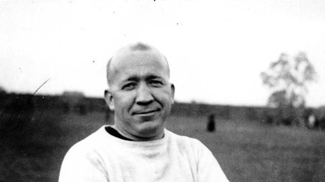 FILE - This is a 1925 photo of Notre Dame football coach Knute Rockne at an unknown location.At a time when college football was generally considered the domain of eastern blue bloods, Notre Dame and Alabama were upstart teams that gave blue collar fans a chance to tweak the elite. About 90 years later, the Fighting Irish and Crimson Tide are the elite - two of college football's signature programs, set to play a national championship next Monday in Miami that could break records for television viewership.  (AP Photo/File)
