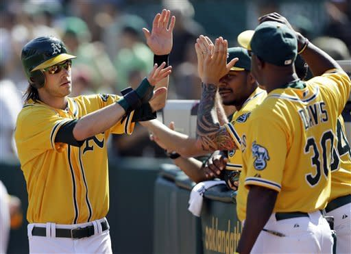 Athletics sweep Rangers to win AL West on last day