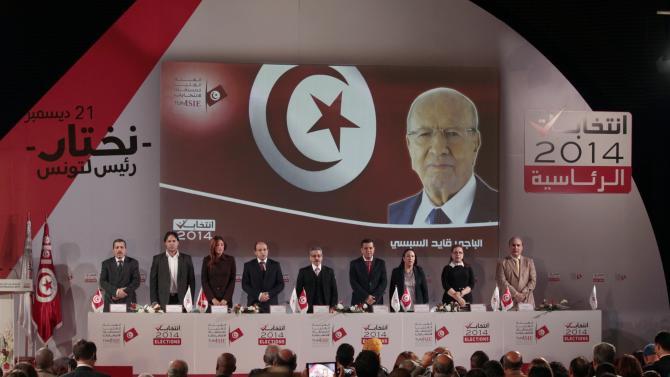 Chafik Sarsar, head of the Independent Election Commission addresses a news conference in Tunis