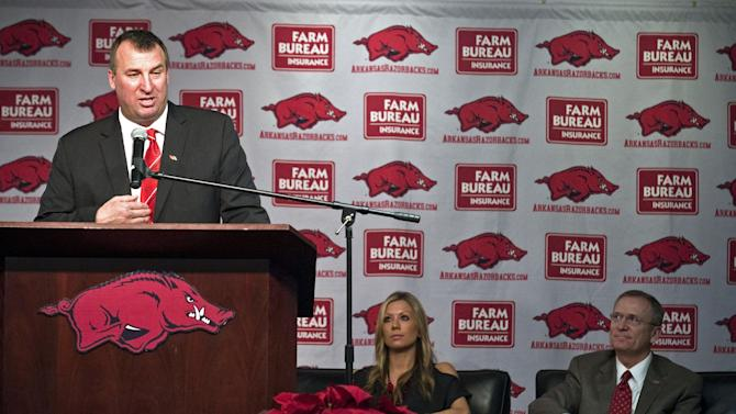 New Arkansas head coach Bret Bielema, left, speaks during an NCAA college football news conference in Fayetteville, Ark., Wednesday, Dec. 5, 2012. At center and right are Bielema's wife Jen and athletic director Jeff Long. Bielema, who will be paid $3.2 million annually for six years, replaces interim coach John L. Smith, who was hired after Bobby Petrino was fired in April. (AP Photo/April L. Brown)