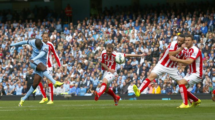 Manchester City's Toure takes a shot on goal during their English Premier League soccer match against Stoke City at the Etihad stadium in Manchester