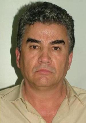 "In this photo released by the Spanish Interior Ministry on Friday Aug. 10, 2012,  a suspected member of a Mexican drug cartel, Jesus Gutierrez Guzman is seen in this hand out photo. The Interior Ministry said Friday Aug. 10, 2012, Spanish police working in a joint investigation with the FBI's Boston Division have halted an attempt by a major Mexican drug smuggling ring to establish a European operation.  Four alleged members of the Sinaloa cartel, including Jesus Gutierrez Guzman, a cousin of ""the biggest drug trafficker in the world,"" Joaquín Archivaldo Guzman Loera known as ""El Chapo"" have been arrested in Madrid a statement says. The statement Friday said Spain was to have been used by the cartel as a gateway for drug importation and distribution throughout Europe but investigators intercepted a container carrying 373 kilos (822 pounds) of cocaine in July, leading to the arrests. (AP Photo/ Spanish Interior Ministry)"