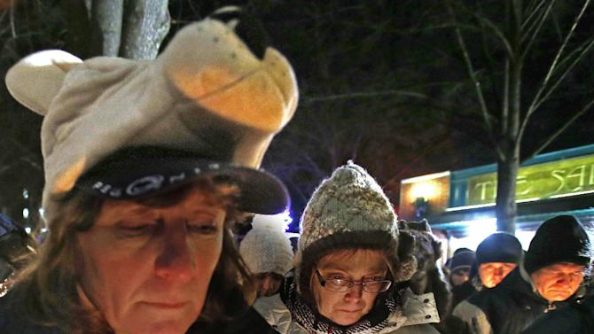 People attends a candlelight memorial on the first anniversary of the death of former Penn State head football coach Joe Paterno, Tuesday, Jan. 22, 2013 in State College, Pa. (AP Photo/Gene J. Puskar)