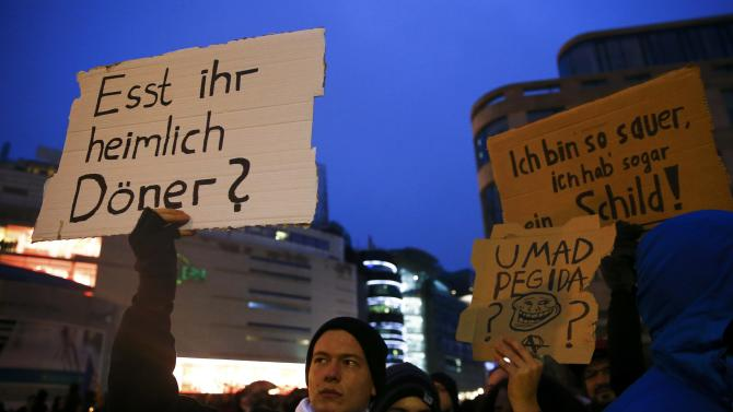 Opponents of the movement of Patriotic Europeans Against the Islamisation of the West (PEGIDA) demonstrate against PEGIDA in Frankfurt