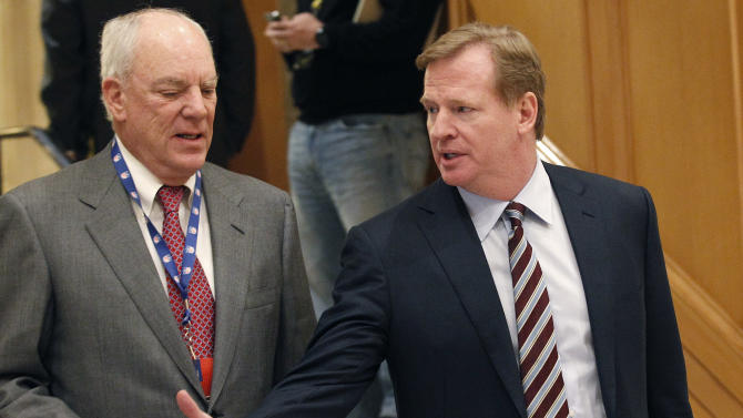 NFL Commissioner Roger Goodell, right, walks and chats with Houston Texans owner Bob McNair at the hotel hosting the NFL owners meeting Wednesday, Dec. 12, 2012, in Irving, Texas. (AP Photo/LM Otero)