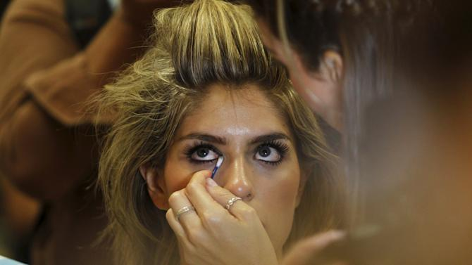 A model has her make up done during the Colombiamoda fashion event in Medellin, Colombia