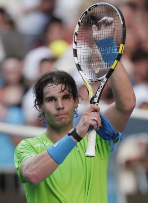 Spain's Rafael Nadal waves to the crowd following his first round match against Alex Kuznetsov of the US at the Australian Open tennis championship, in Melbourne, Australia, Monday, Jan. 16, 2012. (AP Photo/Rick Rycroft)