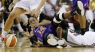Phoenix Mercury's Alexis Hornbuckle, left, loses control of the ball as Seattle Storm's Shekinna Stricklen, right, crashes into her in the first half of a WNBA basketball game, Thursday, Aug. 16, 2012, in Seattle. (AP Photo/Elaine Thompson)