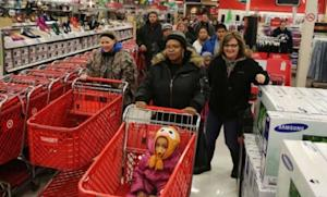 Shoppers enter an Indiana Target on Thanksgiving night, hoping to get a head start on their Black Friday shopping.