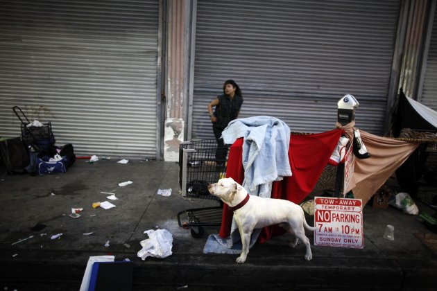 A woman wakes up on downtown Los Angeles' Skid Row