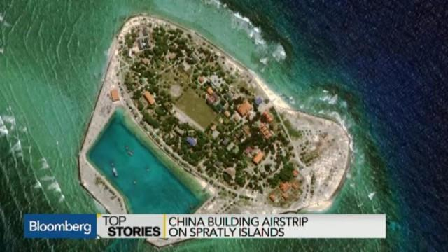 China 'building runway in disputed South China Sea'