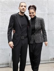U.S. singer Janet Jackson (R) and her boyfriend Wissam Al Mana pose for photographers as they arrive to attend the Giorgio Armani Autumn/Winter 2013 collection at Milan Fashion Week February 25, 2013. REUTERS/Alessandro Garofalo
