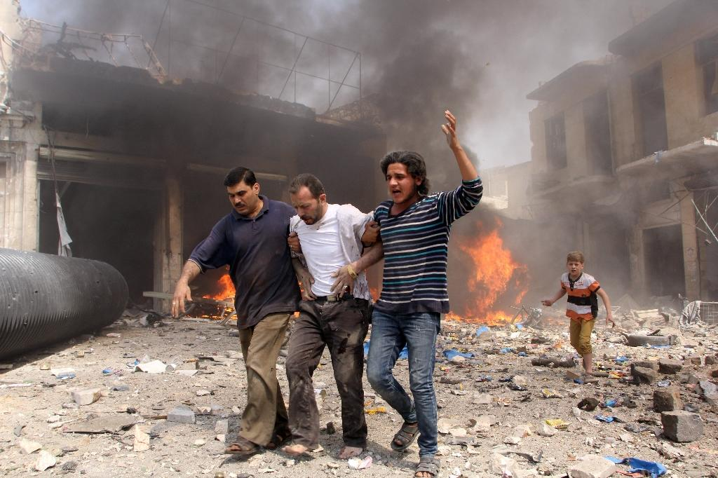 Syria regime barrel bombs kill 37, including children: monitor