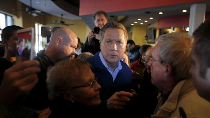 U.S. Republican presidential candidate Kasich greets supporters following a campaign event in Mount Pleasant