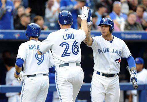 Arencibia, Lind homer as Blue Jays beat Giants