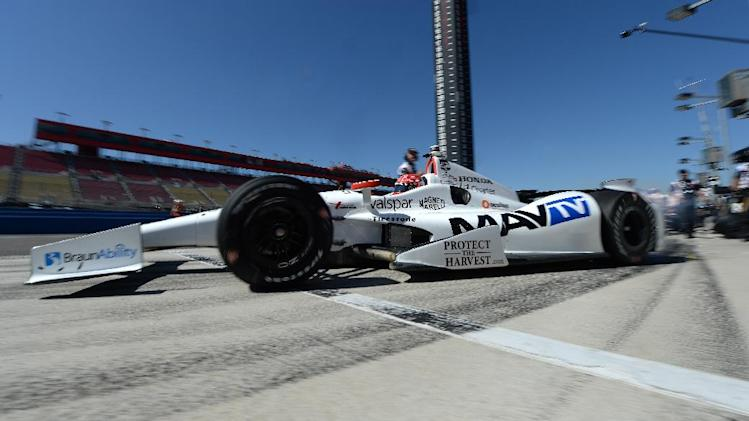 Simon Pagenaud leaves the pits during practice for Saturday's Indycar auto race Friday, Aug. 29, 2014, at Auto Club Speedway, in Fontana, Calif. (AP Photo/Will Lester)